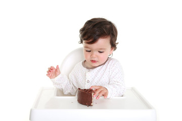 Baby with chocolate cake