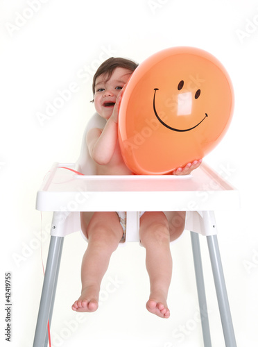 Baby peeping round happy balloon