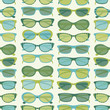 Seamless pattern with sunglasses in green and blue. EPS 10 file.