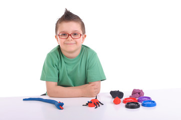 young boy playing with modeling clay