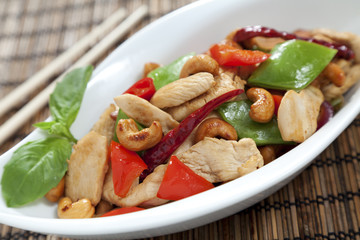 Chicken cashew nuts close up