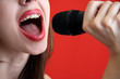 girl sings in  microphone.