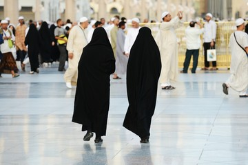 Two Muslim women walking