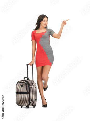 woman with suitcase pointing her finger