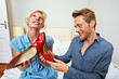 couple in a hotel room with new red shoes