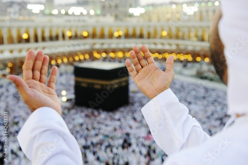 Muslim praying at Mekkah with hands up