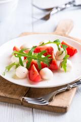Caprese salad on kitchen table