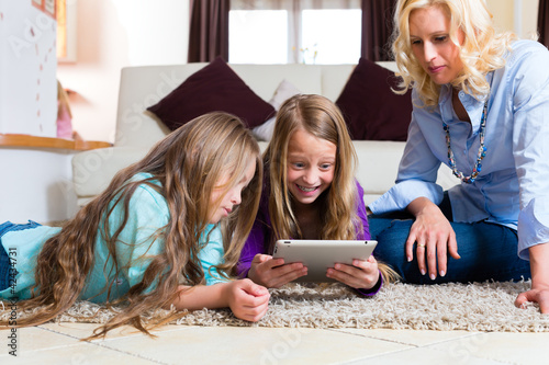 Family playing with Tablet computer at home