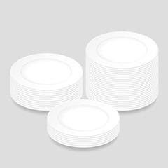 White round plates, stacked in three piles