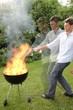Grill mit Flamme in Bewegung