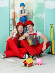 Young couple celebrate to build a house in their site
