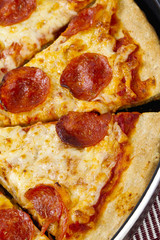cropped image of a pizza