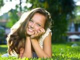 Fototapety Spring Girl in Green Grass