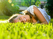 Girl lying on the Field. Happiness