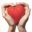 Women Hands holding a heart
