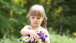 Happy child with a bouquet of flowers