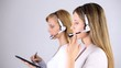 office workers , smiling secretaries, headset,tablet,