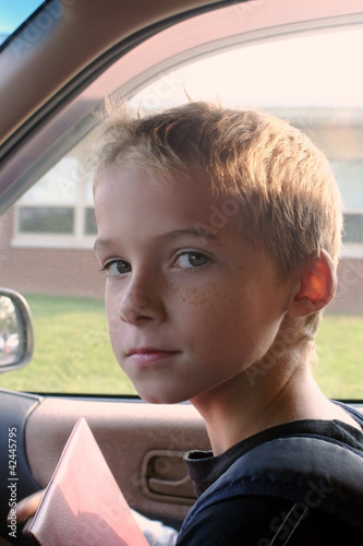 Boy In Car At School