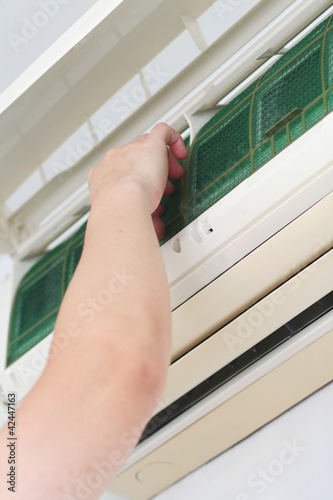 Fitting a clean filter into an air-conditioner