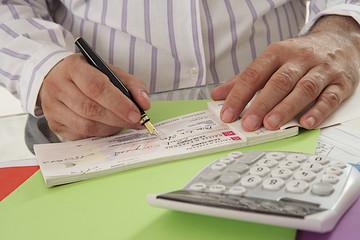Chéquier - Acquiter ses dettes