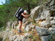 Hiker walking on a rocky path