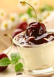dairy dessert with cherries and chocolate sauce