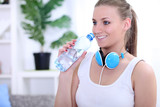 happy young woman holding water bottle