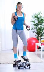 Girl exercising on stepper trainer