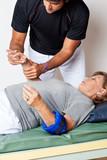 Therapist Examining Woman's Hand
