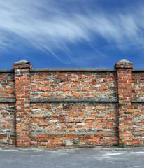 brick wall asphalt floor and sky background