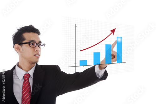 Businessman pointing at chart
