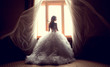 Leinwanddruck Bild - The beautiful bride against a window indoors