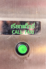 Technology green button call taxi .
