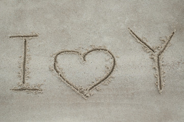"Inscription ""I love You"" on the sand"