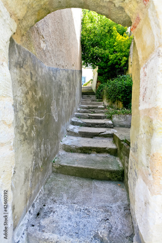 Poster arch and old stone step