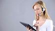 smiling secretaries speak with microphone and earphones