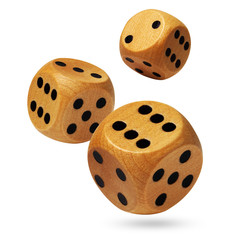 Three wooden dices being rolled head on. Isolated on a white.