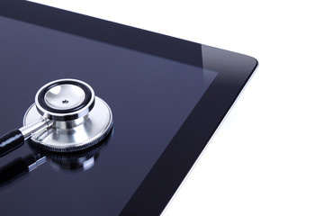 Digital tablet with stethoscope isolated on white