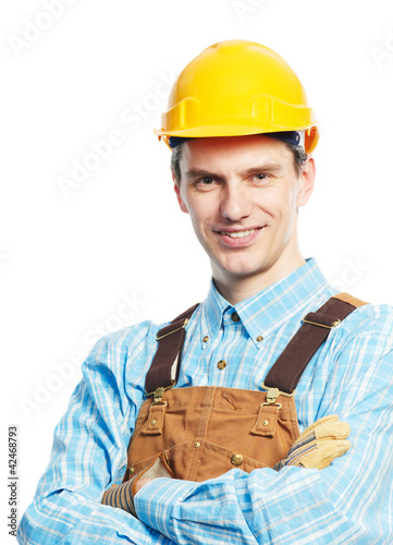 Happy worker portrait in hardhat and overall