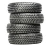 Stack of four car wheel winter tires isolated