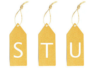 Brown paper tag with letter S T U cut
