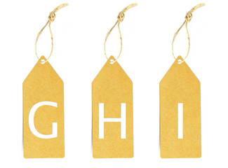 Brown paper tag with letter G H I cut
