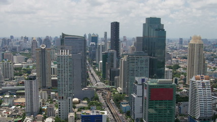 Bangkok Skyscrapers Time Lapse with Car and Train Traffic