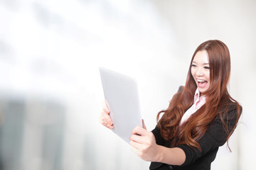 business woman excited looking at  Tablet pc