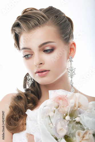 Beautiful young woman face. Wedding. Flowers. Beauty. Freshness