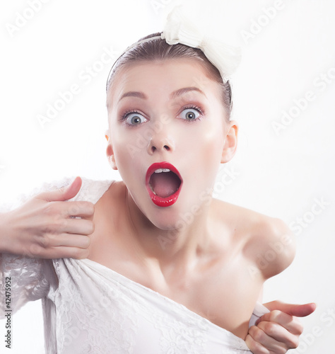 Excited shouting young pretty woman isolated on white background
