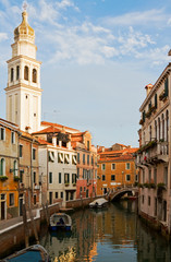 Canal in Venice in afternoon light.