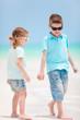 Kids walking at beach
