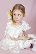 little girl in a white elegant dress