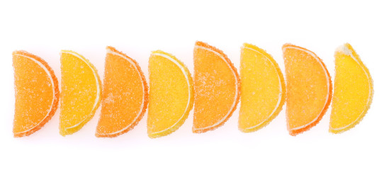 orange jelly candies isolated on white